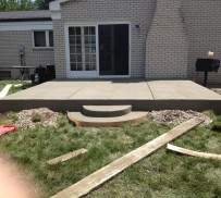 Raised cement patio with stairs.
